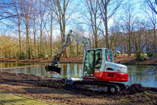 Photo of an excavator digging a pond